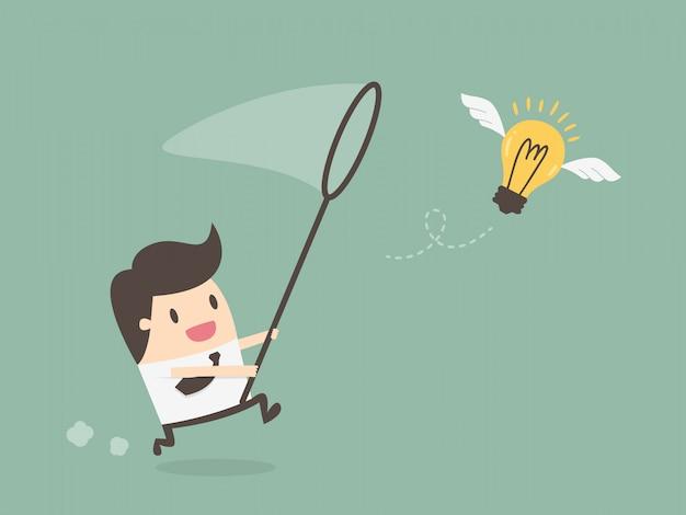 Homme D'affaires, Chassant L'ampoule Volante Vecteur Premium