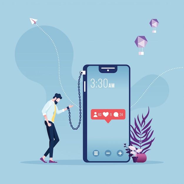 Homme d'affaires enchaîné et enchaîné à un gros téléphone intelligent - métaphore de la dépendance aux réseaux sociaux Vecteur Premium