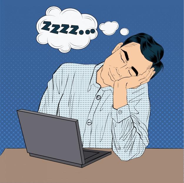 Homme d'affaires endormi au travail style pop art avec ordinateur portable Vecteur Premium