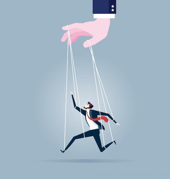 Homme d'affaires marionnette sur des cordes contrôlées à la main Vecteur Premium