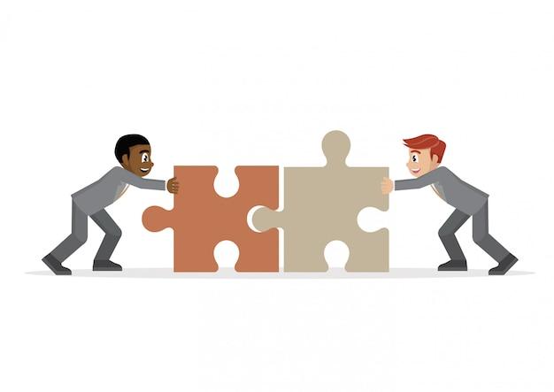 Homme d'affaires poussant deux morceaux de puzzle ensemble. Vecteur Premium
