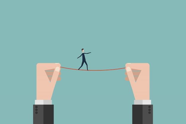 Homme d'affaires promenades sur une corde raide Vecteur Premium