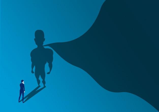 Homme d'affaires à la recherche de succès avec un super-héros avec une ombre de cap sur le mur. ambition et concept de réussite commerciale. pouvoir héros de leadership, motivation et symbole de force intérieure. Vecteur Premium