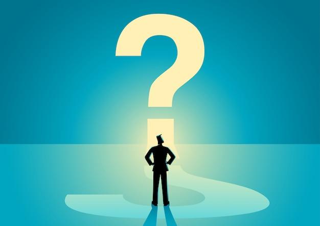 Homme d'affaires en regardant gros point d'interrogation Vecteur Premium