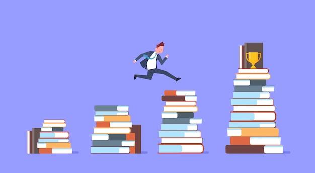 Homme d'affaires sautant par-dessus des piles de livres pour un homme d'affaires gagnant de la coupe d'or Vecteur Premium