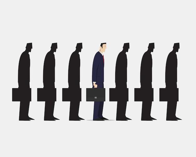 Homme D'affaires Se Démarquant De La Foule Du Groupe De Boursiers Noirs Identiques Sur Fond Blanc. Vecteur Premium