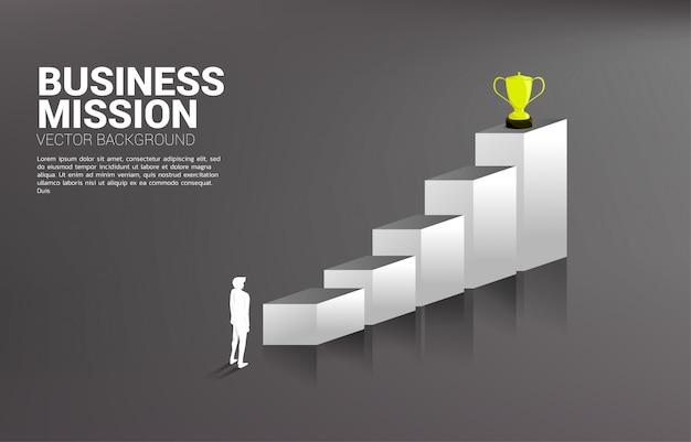 Homme d'affaires de silhouette prévoyant d'obtenir le trophée au sommet du graphique. Vecteur Premium