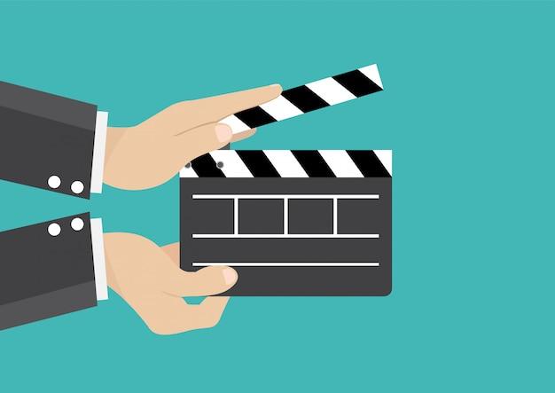 Homme affaires, tenue, film, clap, conseil, cinéma Vecteur Premium