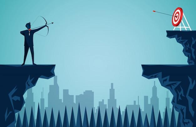 Homme d'affaires en tirant une flèche à travers la falaise opposée à la cible Vecteur Premium