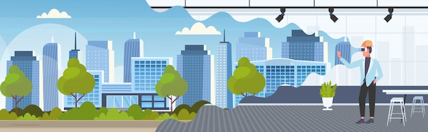 Homme Architecte Dans Un Casque Portant Des Lunettes Numériques Réalité Virtuelle 3d Bâtiment Ville Modèle Vr Modélisation Casque Vision Concept Moderne Bureau Intérieur Horizontal Pleine Longueur Vecteur Premium