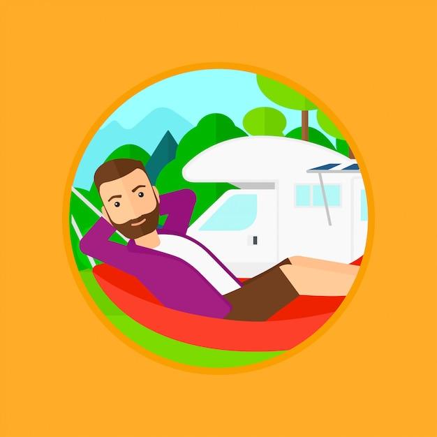 Homme couché dans un hamac devant le camping-car. Vecteur Premium
