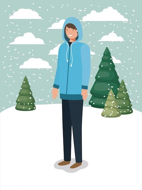 Homme dans la neige avec des vêtements d'hiver Vecteur Premium