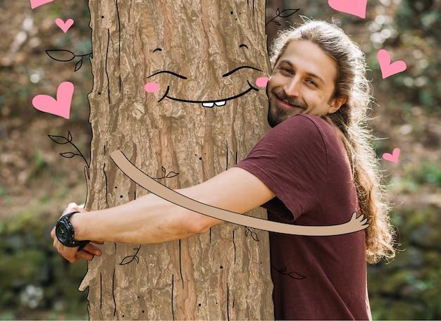 Homme Embrassant Un Arbre Heureux Vecteur gratuit