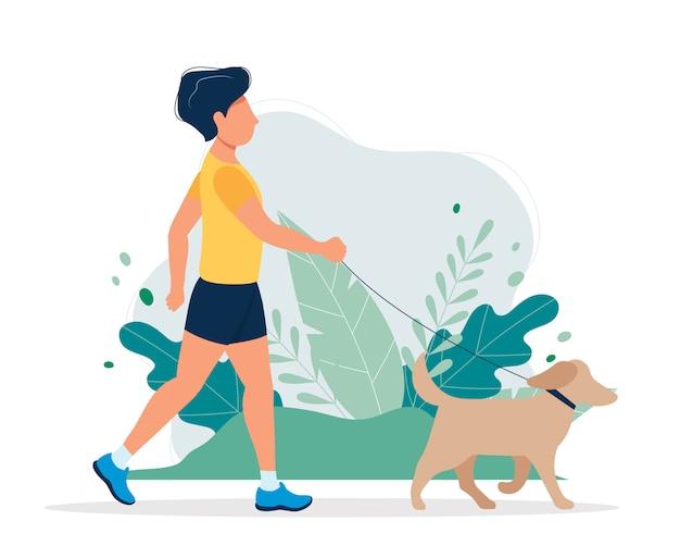 Homme heureux avec un chien dans le parc. Vecteur Premium