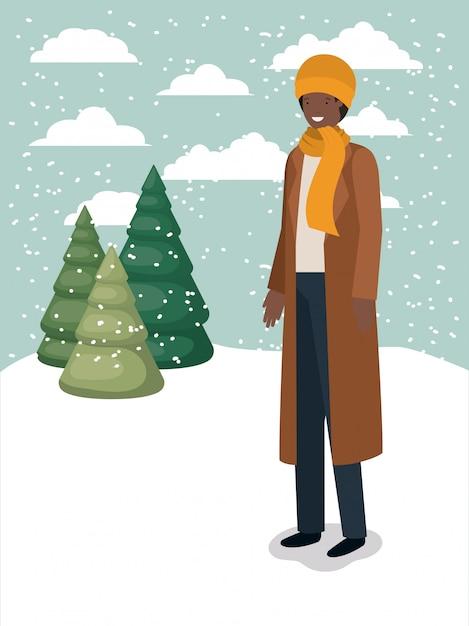 Homme noir dans le paysage de neige avec des vêtements d'hiver Vecteur Premium