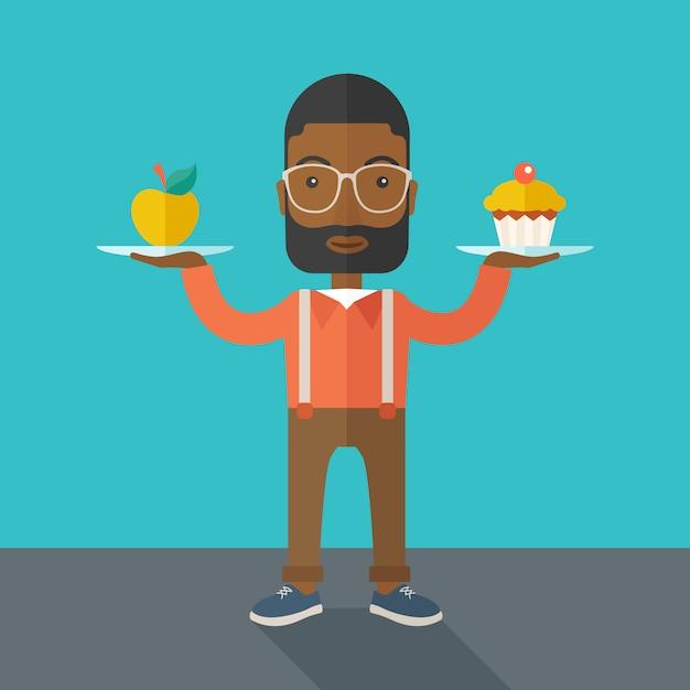 L'homme porte avec ses deux mains cupcake et pomme. Vecteur Premium