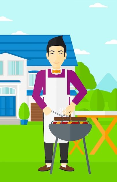 Homme prépare le barbecue Vecteur Premium