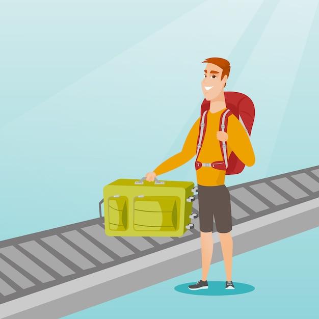 Homme ramassant la valise du tapis roulant. Vecteur Premium