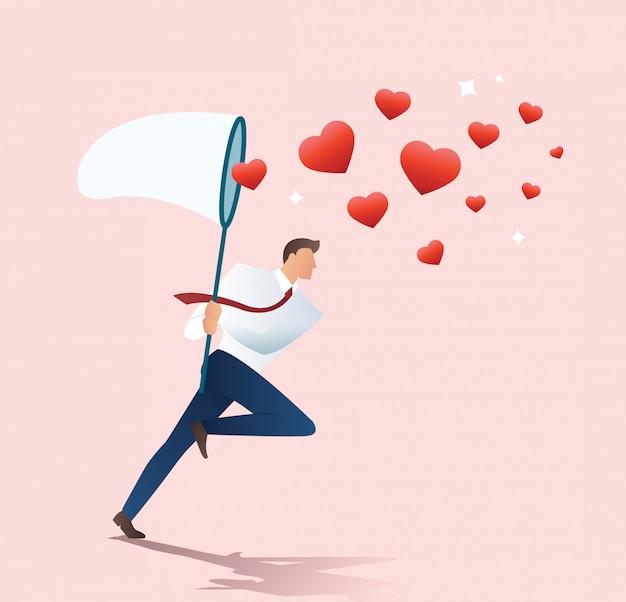 Homme tenant un filet de papillon essayant d'attraper le coeur Vecteur Premium