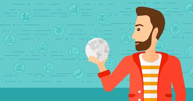 Homme tenant un globe. Vecteur Premium