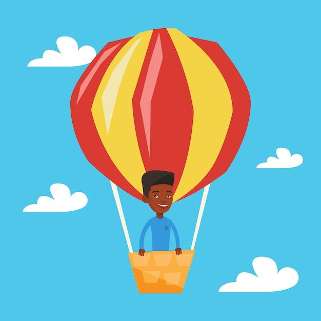 Homme Volant Dans L'illustration De Montgolfière. Vecteur Premium