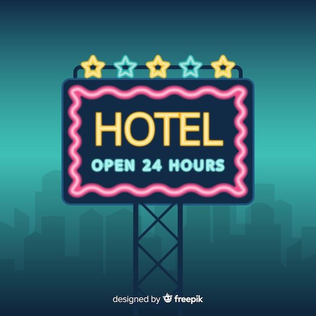 Hôtel, signe néon, fond Vecteur gratuit