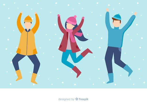 Illustration design plat jeunes portant des vêtements d'hiver sautant Vecteur gratuit