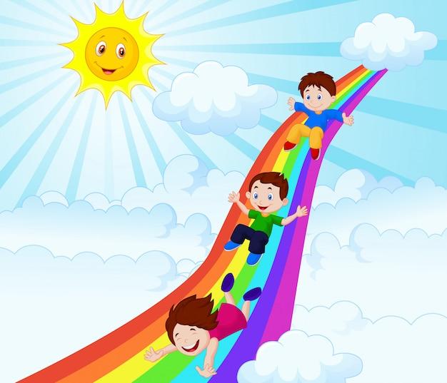 Illustration d'enfants glissant sur un arc en ciel Vecteur Premium