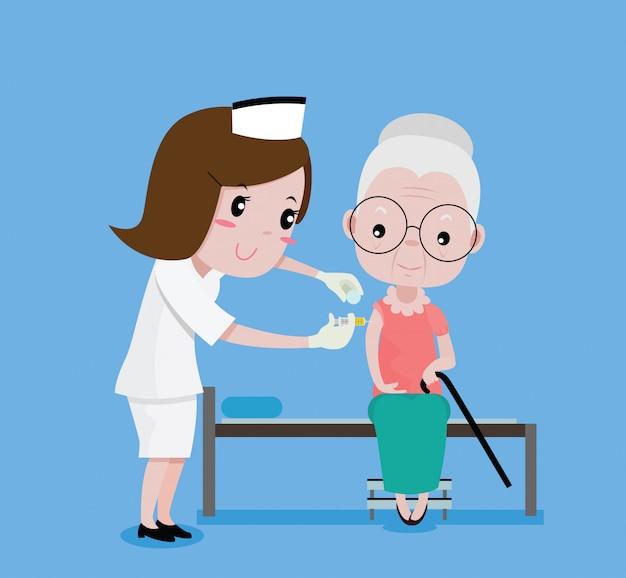 Les infirmières ont reçu une femme plus âgée Vecteur Premium