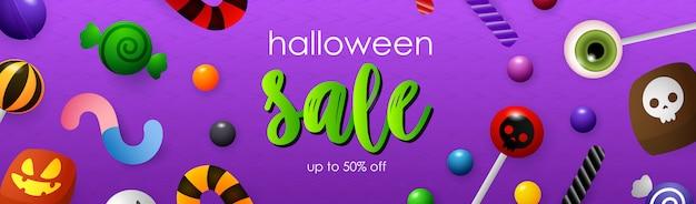 Inscription de vente d'halloween avec sucettes et bonbons Vecteur gratuit