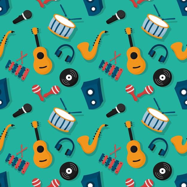 Instruments de musique de modèle sans couture isolés sur fond bleu. Vecteur Premium