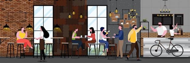Intérieur de café moderne dans un style loft avec plein de clients Vecteur Premium