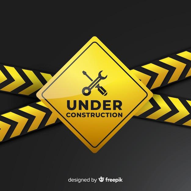 Jaune sous construction signe réaliste Vecteur gratuit