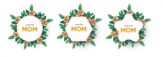 Je t'aime maman lettrage sur cadre avec guirlande de fleurs et de plantes. carte de voeux fête des mères Vecteur Premium