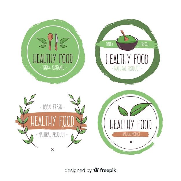 Jeu de logo d'aliments sains dessinés à la main Vecteur gratuit