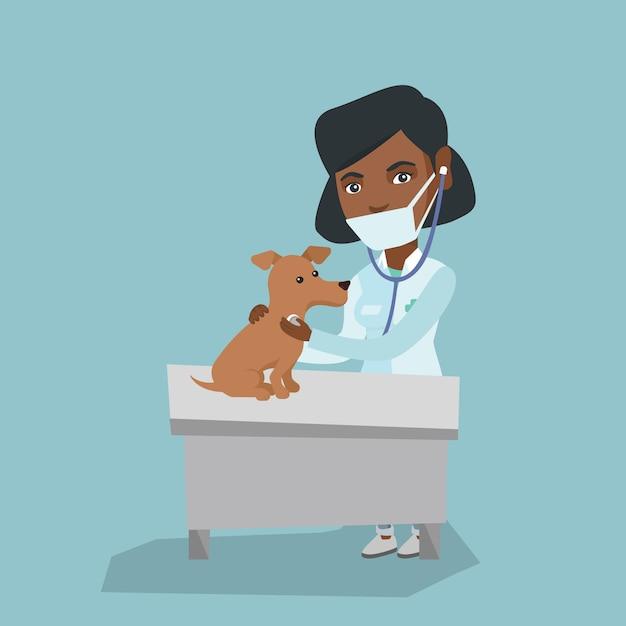 Jeune chien d'examen vétérinaire afro-américaine. Vecteur Premium