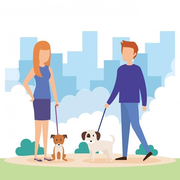 Jeune couple avec des chiens dans le parc Vecteur gratuit