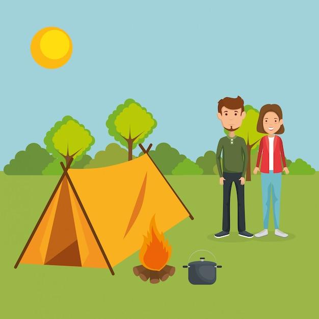 Jeune couple dans la zone de camping Vecteur gratuit