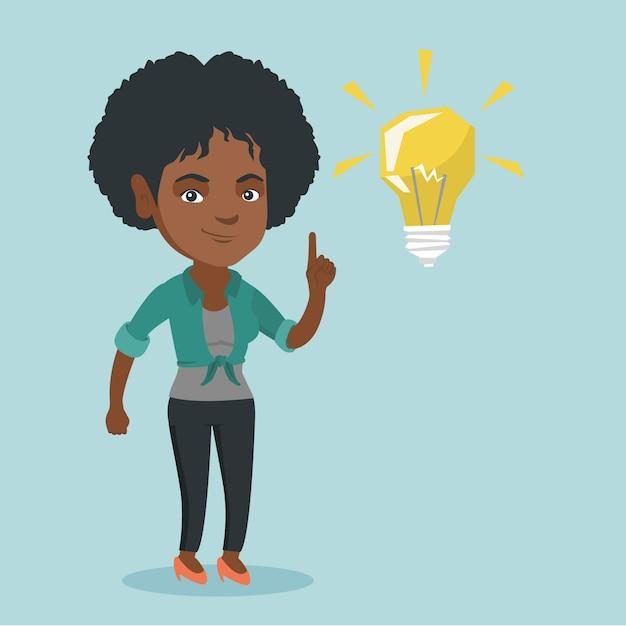 Jeune étudiant Africain Pointant Sur Ampoule Idée. Vecteur Premium