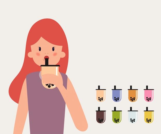 Jeune femme boire du thé au lait à bulles. Vecteur Premium