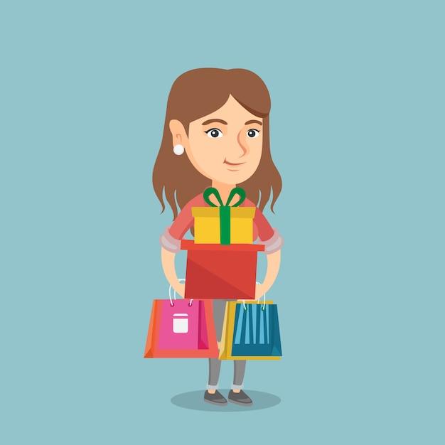 Jeune femme tenant des sacs à provisions et des coffrets cadeaux. Vecteur Premium