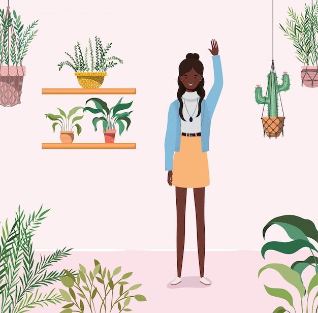 Jeune fille afro dans le personnage de jardin Vecteur Premium