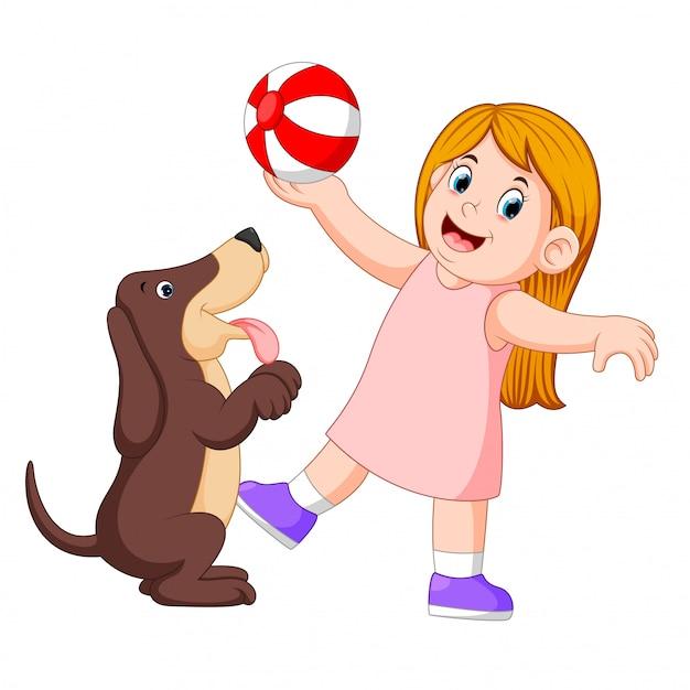 Jeune fille jouant au ballon avec chien Vecteur Premium