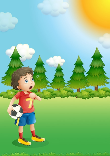 Un jeune footballeur sur la colline Vecteur gratuit
