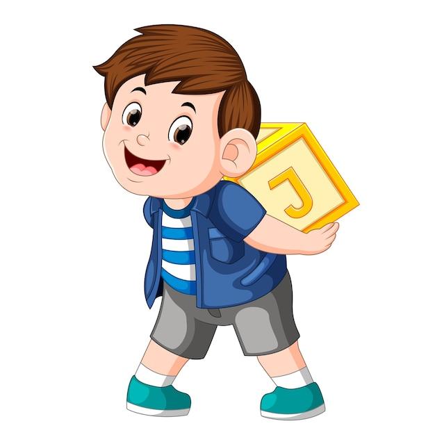 Jeune Garçon Jouant Un Bloc D'alphabet Vecteur Premium