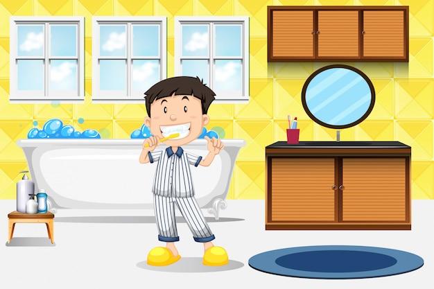 Jeune garçon se brosser les dents Vecteur Premium