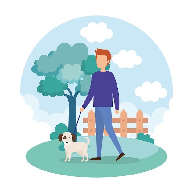 Jeune homme avec un chien dans le parc Vecteur gratuit