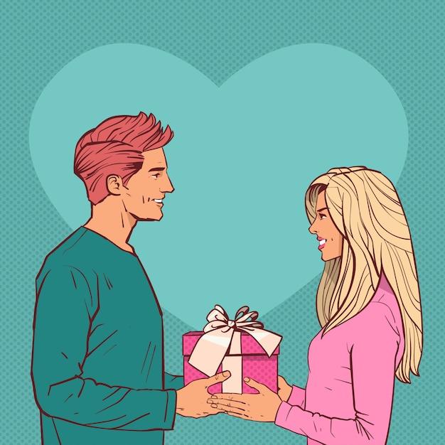 Jeune homme donner une boîte-cadeau à une femme en forme de coeur concept de jour de fête de la saint-valentin Vecteur Premium
