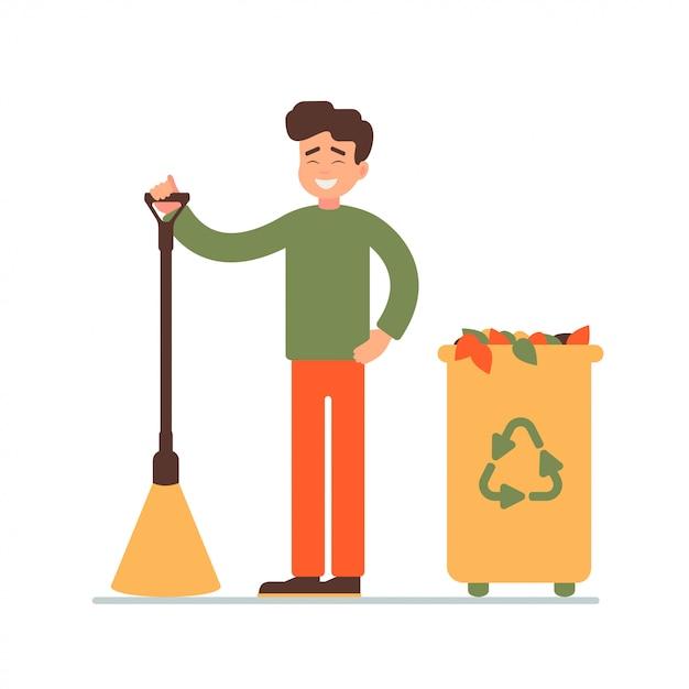 Jeune homme ramassé des feuilles mortes dans la poubelle pour le recyclage Vecteur Premium