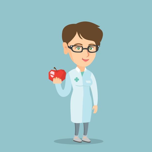 Jeune nutritionniste caucasien offrant des pommes fraîches. Vecteur Premium